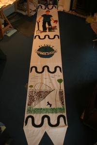 5 metre cloth banner planet south bank logo and gardener